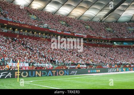 WARSAW, POLAND - JUNE 10, 2019: Qualifications Euro 2020  match Poland - Israel 4:0. Supporters of Poland with the small national flags. - Stock Photo