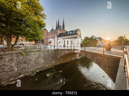 Old stone bridge, Dombron, at the Fyris river (Fyrisan) at sunset in Uppsala city centre. Sweden, Scandinavia. - Stock Photo