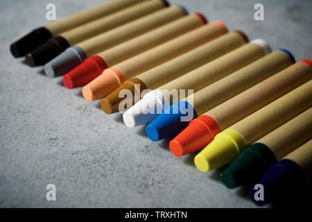 Group of wax crayons on a table.