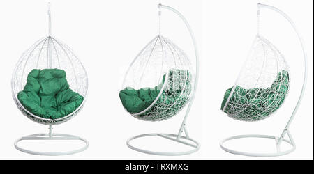 Garden wicker furniture. Hanging swing with stand and soft pillow. Set on a white background. - Stock Photo