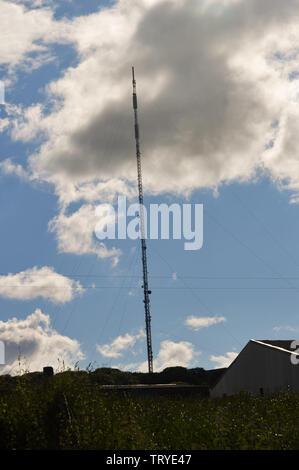 Communications mast in Afonwen, North Wales UK - Stock Photo