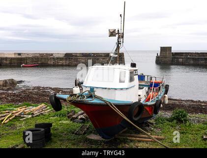 Inshore Fishing Boat in Harbour at Craster on the Northumberland Coast England United Kingdom UK - Stock Photo