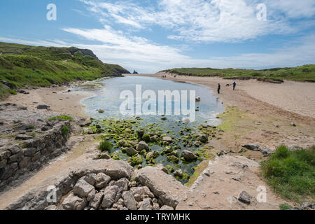 Coastal scenery at Broad Haven beach in Pembrokeshire, Wales - Stock Photo