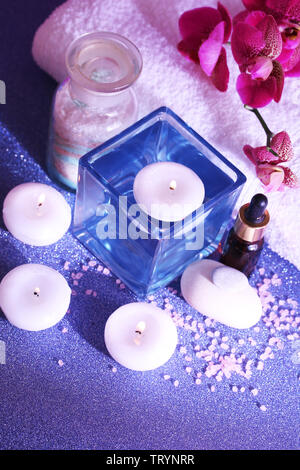 Beautiful spa setting with orchid close-up - Stock Photo