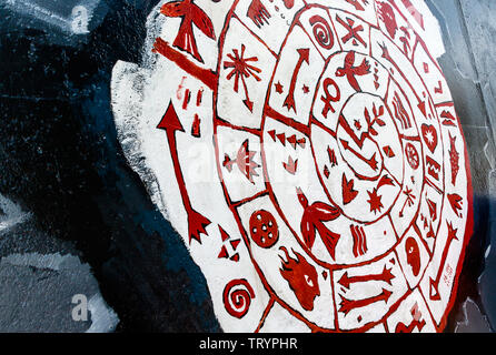 BERLIN, GERMANY - July 27, 2018: Graffiti art on original section of Berlin Wall at East Side Gallery in Friedrichshain. - Stock Photo