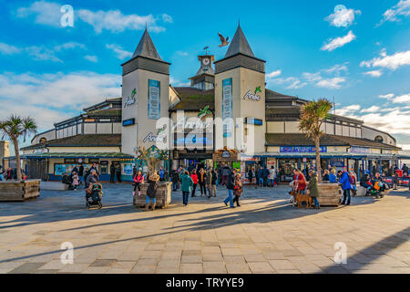 BOURNEMOUTH, UNITED KINGDOM - JANUARY 01: This is the entrance to Bournemouth pier where people come for restaurants cafes and shops on January 01. 20 - Stock Photo