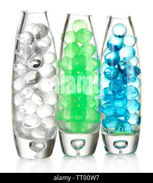 Transparent vases with hydrogel isolated on white - Stock Photo