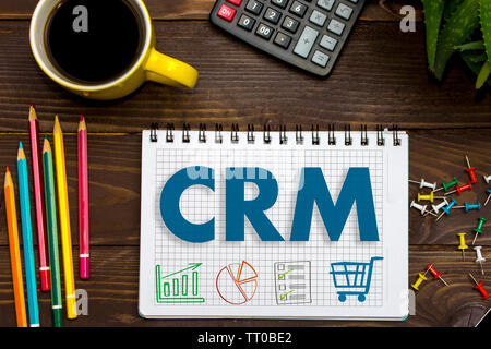 CRM. Customer Relationship Management. Tablet on the office Desk - Stock Photo
