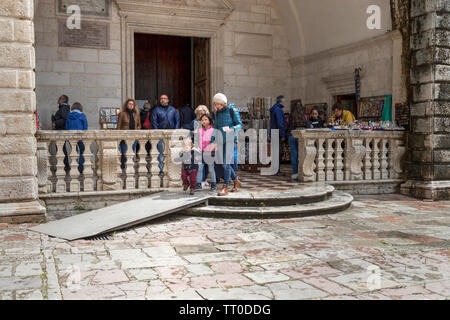 Montenegro, April 30th 2019: Street scene with tourists and locals in the Old Town of Kotor - Stock Photo