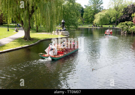 Swan boats in the lagoon at the Boston Public Garden - Stock Photo