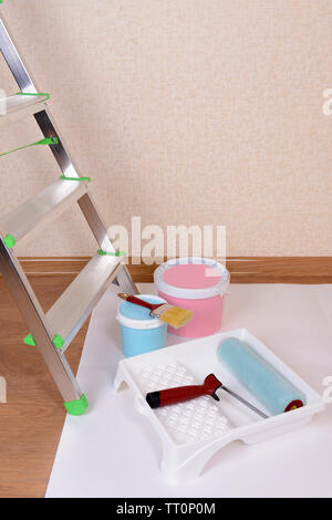 Metal ladder and paint in room - Stock Photo