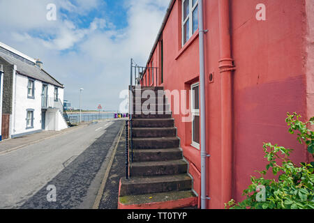 Front stairs outside a colourful terraced traditional house in Ferryden, Montrose, Angus, Scotland, UK. - Stock Photo