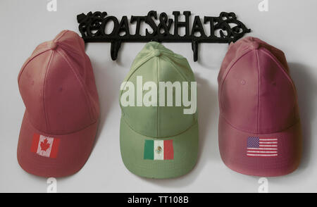 Three hats on the hooks: American, Mexican, Canadian.. - Stock Photo