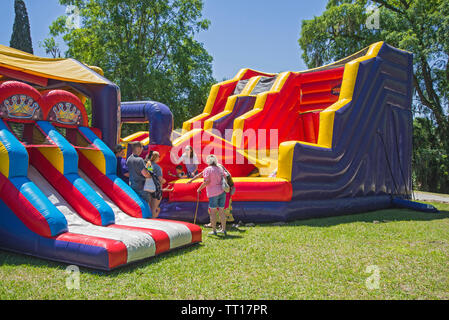 Daredevil Island extreme inflatable at Pioneer Days annual festival in High Springs, Florida. - Stock Photo