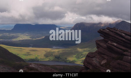 A view looking down from Ben More Coigach ,Scotland on the surrounding glen and lochs in the Coigach Peninsula - Stock Photo
