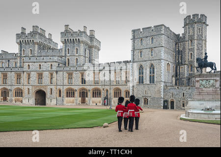 WINDSOR, ENGLAND -MAY, 24 2018: Changing of the guards at Windsor Castle, the residence of the British Royal Family at Windsor in the English county - Stock Photo