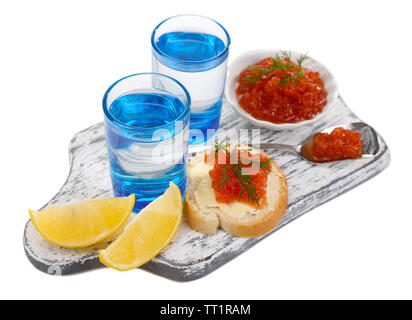 Sandwich with caviar and vodka on wooden board isolated on white - Stock Photo