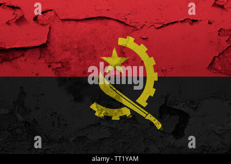 Angola flag painted on the cracked grunge concrete wall - Stock Photo