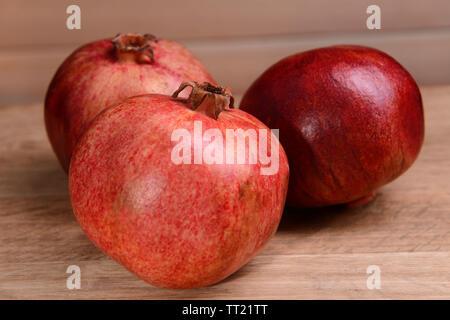 Ripe pomegranates on table close-up - Stock Photo