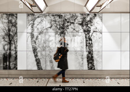 Woman walking in Brussels Central train station with blur motion, Belgium. Concept of transport in the capital of the European Union. - Stock Photo