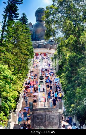 Tourist Flocking to the Tian Tan Buddha Statue, Lantau, Hong Kong - Stock Photo