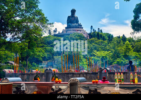 Low Angle View of the Tian Tan Buddha Statue with Offerings, Lantau, Hong Kong - Stock Photo