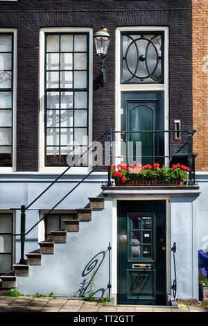 View of a Traditional Dutch House Entrance in Amsterdam, Netherlands - Stock Photo