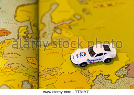 Mattel Hot Wheels white Nissan Fairlady car on a page with