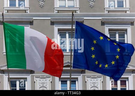 Waving Italian and European flags. Italy - Stock Photo
