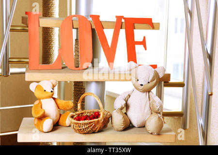 Decorative letters forming word LOVE with teddy bears on home stairs - Stock Photo