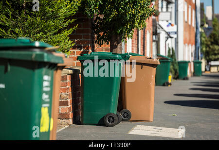 Wheelie bins awaiting collection on a street in the United Kingdom. - Stock Photo