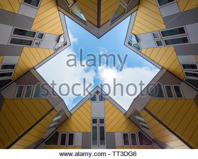 Rotterdam, The Netherlands - October 26 2018: The yellow cube houses photographed from below with a blue sky and some clouds. Designed by Piet Blom. - Stock Photo
