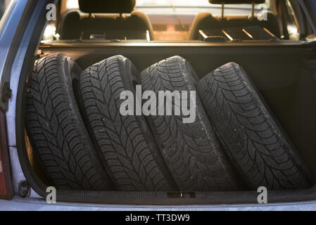 Tires on the way to a tire change - Stock Photo