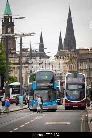 Lothian buses in the centre of the City of Edinburgh, Scotland. - Stock Photo