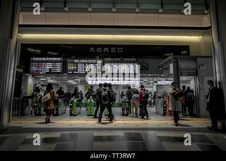 Tokyo, Japan. April 3, 2017. Passengers entering and leaving Tokyo station. - Stock Photo