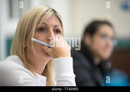 students attending adult education college - Stock Photo