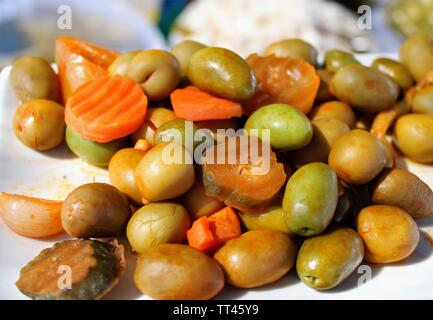 Mix of color and flavor with pickled olives , peppers and carrots - Stock Photo