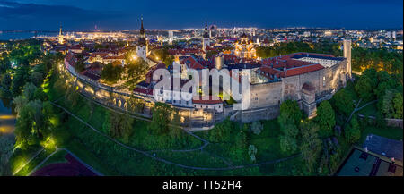Tallinn aerial panorama night view of the medieval old city and Toompea castle - Stock Photo