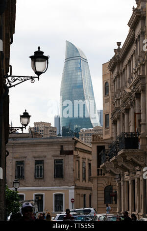 One of the Flame Towers, one of a trio of skyscrapers in Baku, Azerbaijan as seen from the Old City - the historical heart of the capital. - Stock Photo