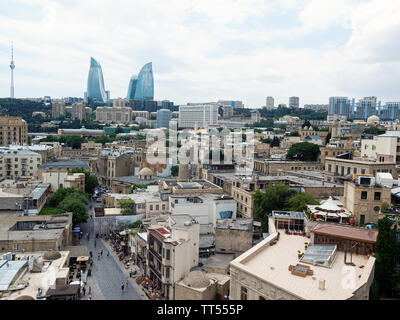 A view of Baku from the top of Maiden's Tower.  The famous Flame Towers can be seen in the background. Baku, Azerbaijan - Stock Photo