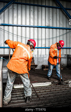 Men working at Bahia las Minas Thermal Power Plant. Colon, Panama. - Stock Photo