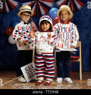 Three children dressed in knitted clothes to get out the vote - Stock Photo
