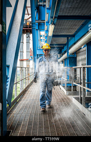 Man working at Bahia las Minas Thermal Power Plant. Colon, Panama. - Stock Photo