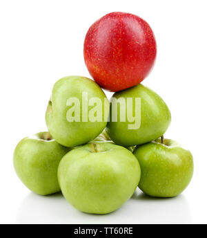 Juicy apples in shape of pyramid isolated on white - Stock Photo