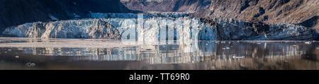 Panorama/ Pano vista of Johns Hopkins Glacier, a 12 mile long glacier in Glacier Bay National Park and Preserve, Alaska. Captured October 2017. - Stock Photo