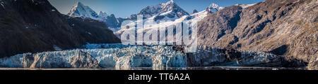 Johns Hopkins Glacier, a 12 mile long glacier in Glacier Bay National Park and Preserve, Alaska, October 2017. Mount Orville and Mount Wilbur in back. - Stock Photo