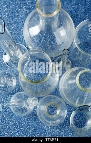 Different laboratory glassware on color background - Stock Photo