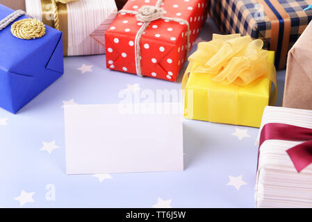 Pile of colorful gifts on blue background with stars - Stock Photo