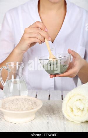 Beautician makes cosmetic facial masks, close-up - Stock Photo