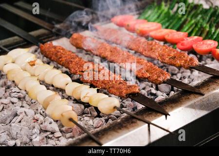 Traditional Turkish Adana Shish Kebap or Kebab - Stock Photo